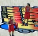 Jude Shimmel and Shoni Shimmel at half court during the Women's Final Four semifinal game against Cal.